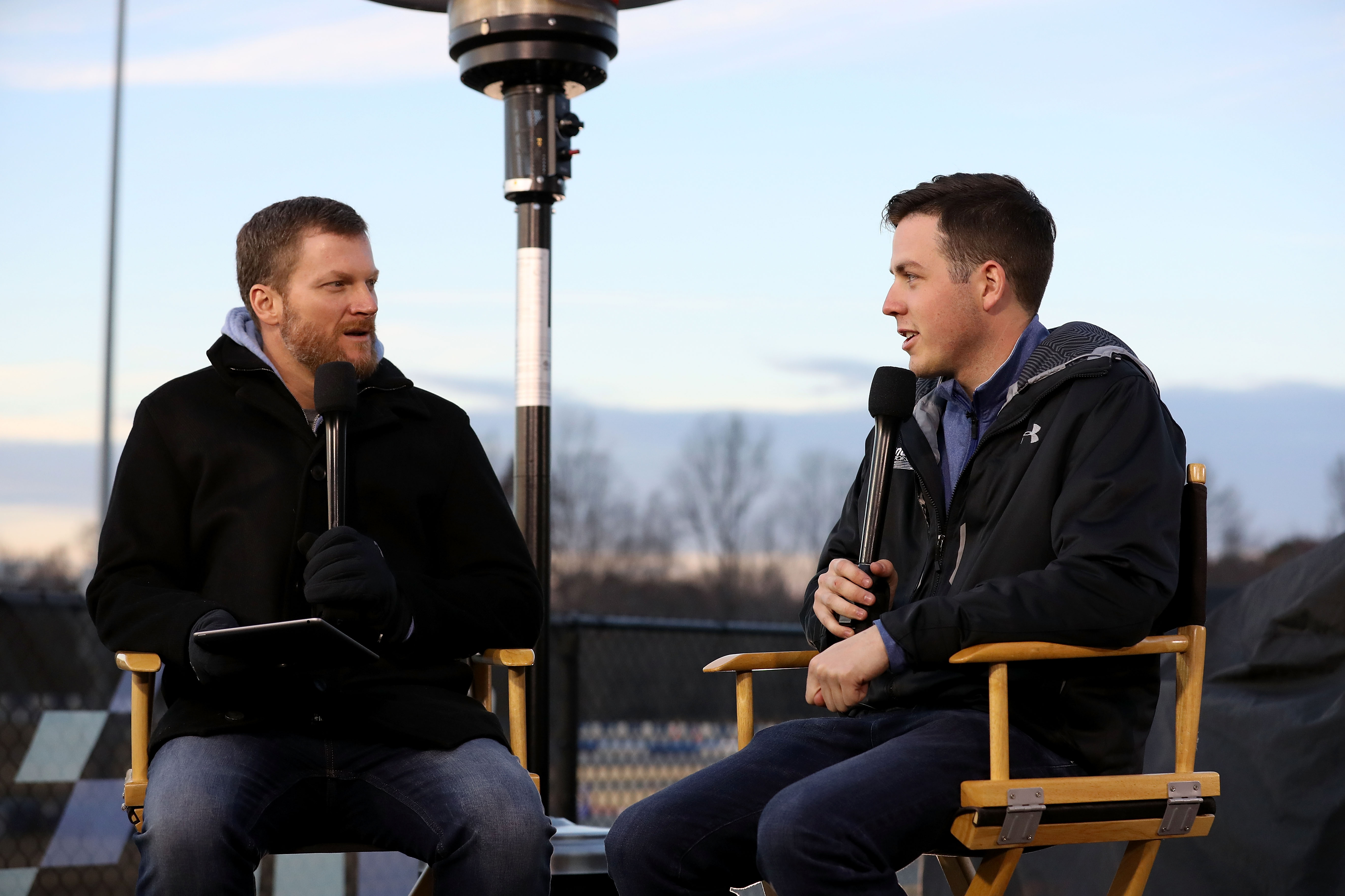 MOORESVILLE, NC - DECEMBER 06: (L-R) Dale Earnhardt Jr. and Alex Bowman interact with fans and media during the Nationwide 2019 Paint Scheme Reveal at GoPro Motorplex on December 6, 2018 in Mooresville, North Carolina. (Photo by Streeter Lecka/Getty Images)   Getty Images