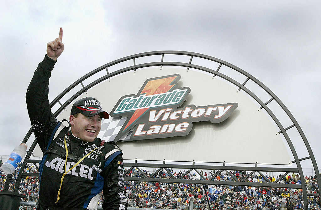 DOVER, DE - JUNE 1: Ryan Newman celebrates in victory lane after winning in his #12 Penske Racinng Dodge during the NASCAR Winston Cup MBNA Armed Forces Family 400 at Dover International Speedway on June 1, 2003 in Dover, Delaware. (Photo by Jon Ferrey/Getty Images) | Getty Images