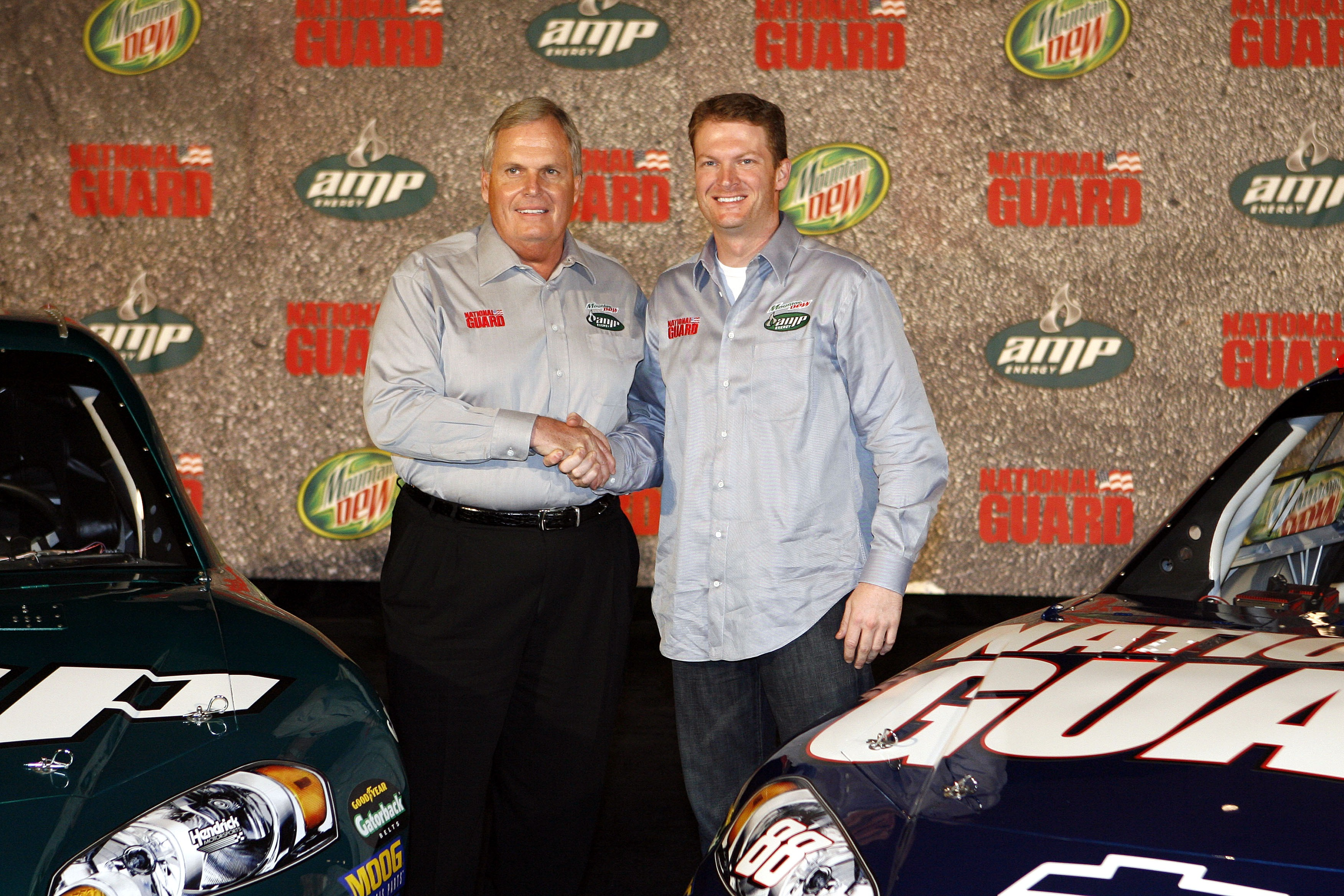 DALLAS, TX - SEPTEMBER 19: Dale Earnhardt Jr. (R) of the Hendrick Motorsports Racing Team poses with Rick Hendrick and his new cars on September 19, 2007 at the Dallas Convention Center in Dallas, Texas. (Photo by Layne Murdoch/Getty Images) | Getty Images